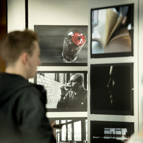 Man looking at photos in an art gallery