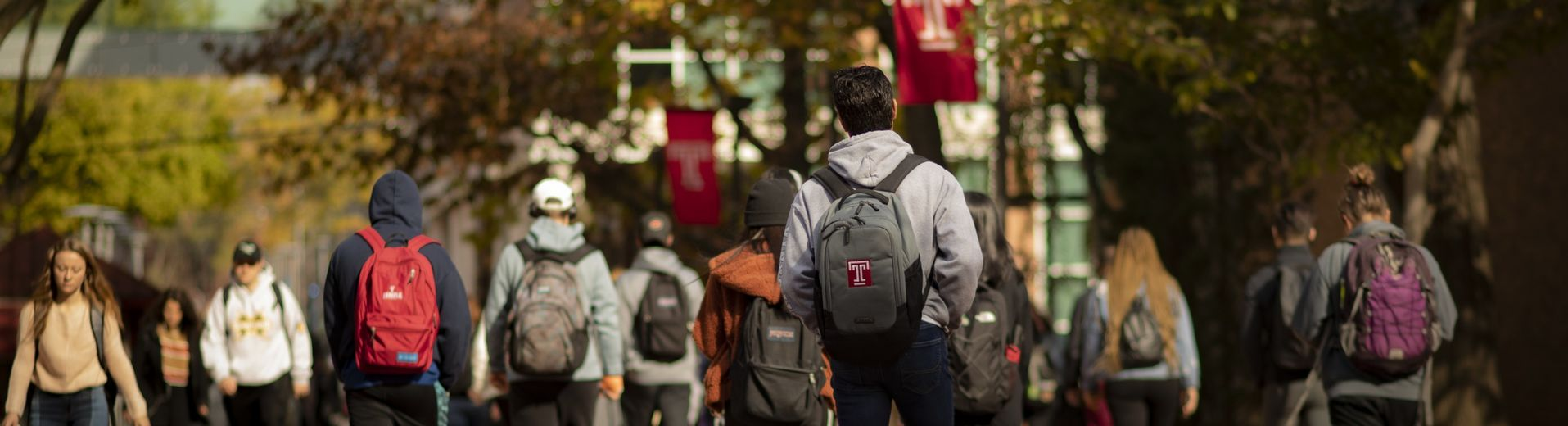 Students walking on Liacouras Walk on campus