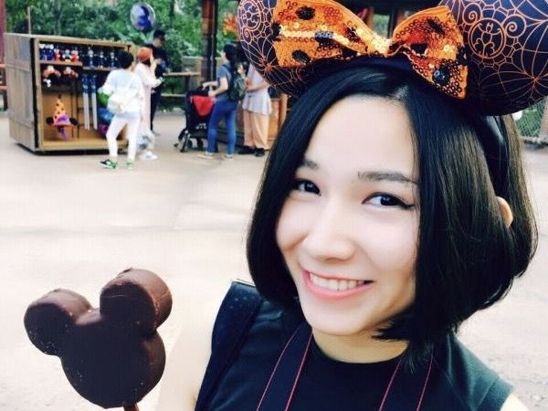 Ching Shih Holding a Mickey Mouse-shaped ice cream bar